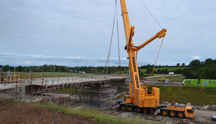 Crane lifting a beam into place.