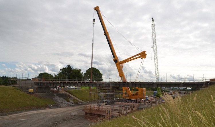 Dobbins lane bridge seen from the far                           side with crane lifting.