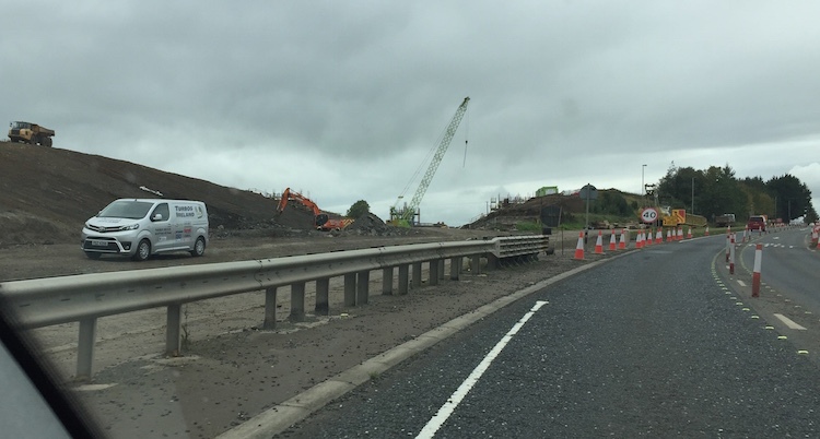 View east from M22 towards large                           excavation in bank.